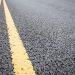 yellow-road-marking-road-surface_1252-1139